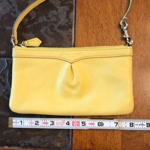 Dooney & Bourke wristlet yellow